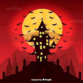 Fantastica casa infestata di halloween con design piatto