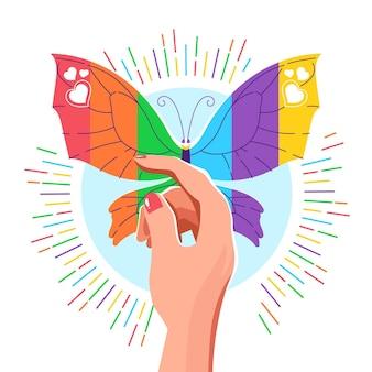 Farfalla con il concetto di giorno di orgoglio della bandiera del lgbt