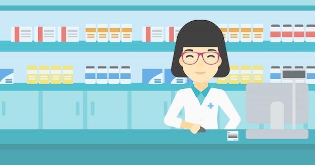 Farmacista al bancone con monitor del computer.