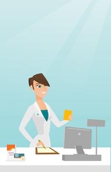 Farmacista che scrive una prescrizione.