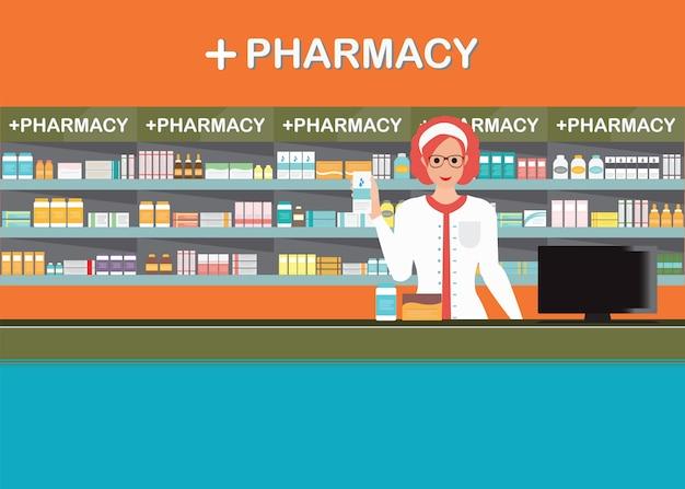 Farmacista femminile al banco in un negozio di farmacia