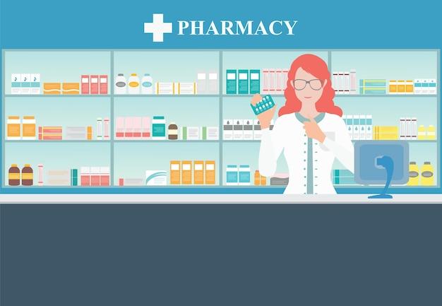 Farmacista femminile al banco in una farmacia.