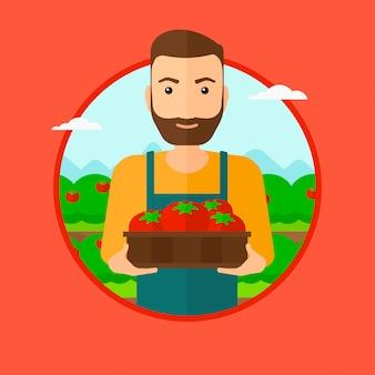 Farmer che raccoglie pomodori.