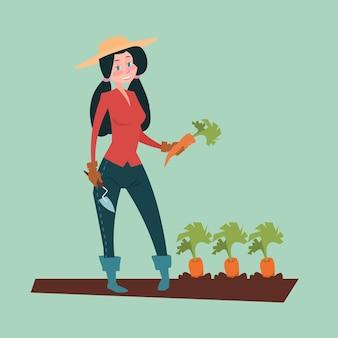 Farmer woman gather carot harvest eco farming