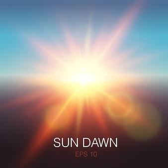 Fasci realistici di alba del sole di colore arancione e riflessi sull'obiettivo su cielo blu