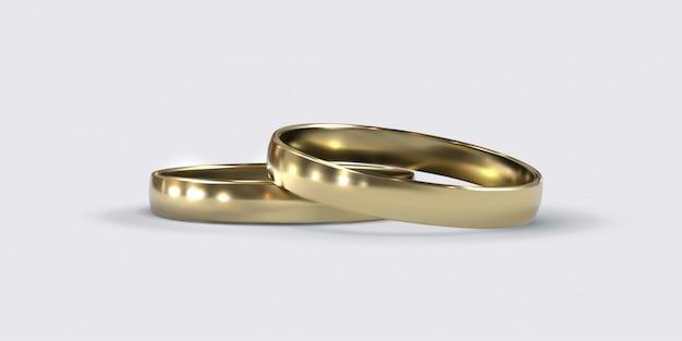Fedi nuziali dorate. oggetti dei gioielli isolati su fondo bianco. concetto di matrimonio o proposta.