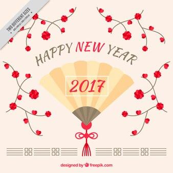 Felice anno nuovo sfondo con ventilatore e fiori