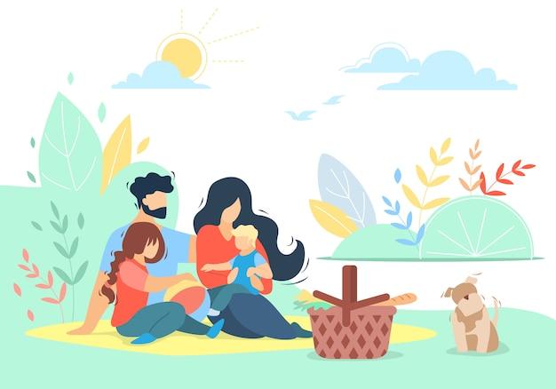 Felice famiglia amorevole di madre, padre, figlia e figlio su picnic con pet all'aperto