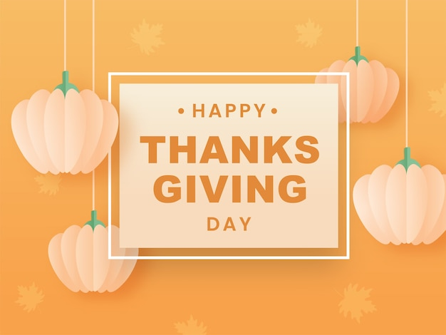 Felice giorno del ringraziamento testo su sfondo arancione chiaro decorato con zucche di carta appese.