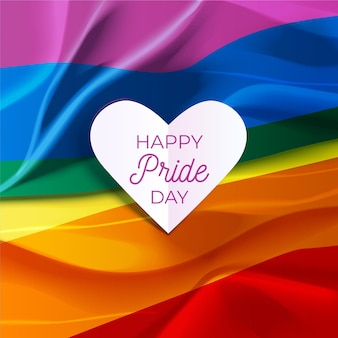 Felice giorno dell'orgoglio scritte in una bandiera cuore e arcobaleno
