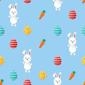 Felice giorno di pasqua carino seamless. coniglietto e carota. conigli isolati su sfondo blu.