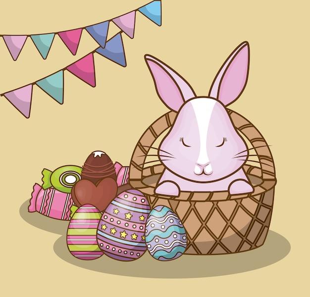 Felice giorno di pasqua con gagliardetti decorativi e coniglietto carino con caramelle