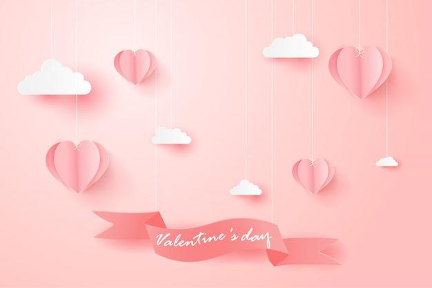 Felice giorno di san valentino biglietto di auguri con palloncini a forma di cuore.