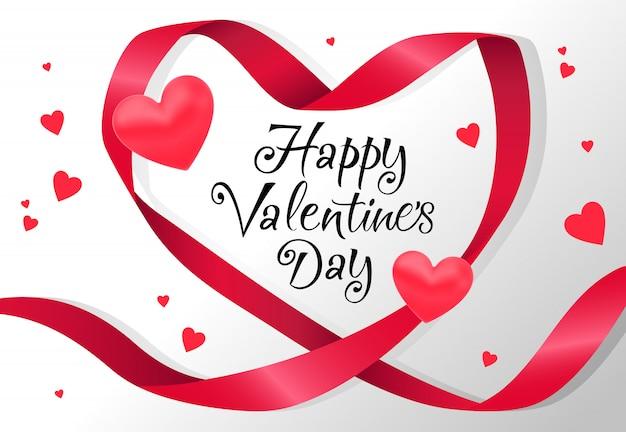Felice giorno di san valentino lettering nel telaio del nastro a forma di cuore rosso