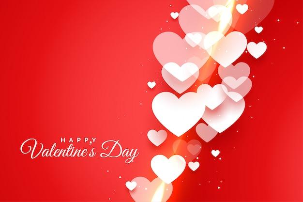Felice giorno di san valentino rosso con carta di cuori bianchi