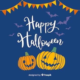 Felice halloween lettering sfondo con zucche e ghirlanda