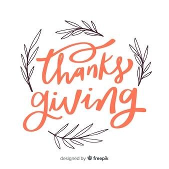 Felice ringraziamento lettering con rami