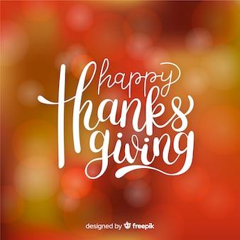 Felice ringraziamento lettering su sfondo sfocato