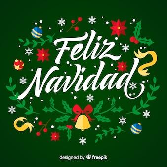 Feliz navidad lettering con ornamenti