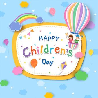 Festa dei bambini con ragazzo e ragazza in mongolfiera e arcobaleno