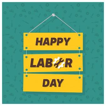 Festa del lavoro felice sul verde sfondo patterened