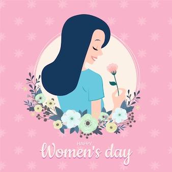 Festa della donna con donna che sente l'odore di un bel fiore