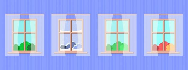 Finestre con diverse stagioni e paesaggi meteorologici