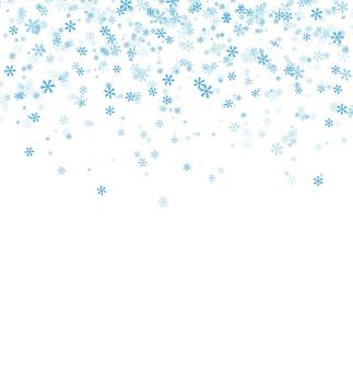 Fiocchi di neve blu che cadono su sfondo bianco