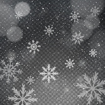 Fiocchi di neve su uno sfondo trasparente bokeh