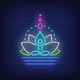 Fiore di loto e figura che meditating insegna al neon. meditazione, spiritualità, yoga.