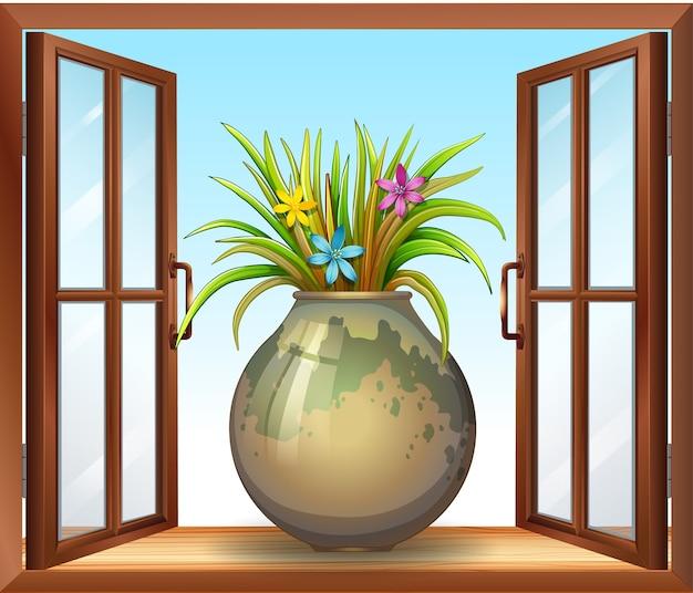 Fiore in vaso vicino alla finestra