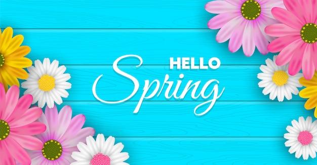Fiori della primavera sull'insegna di legno blu della tavola