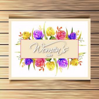 Fiori di rosa colorati con lettering elegante della giornata della donna