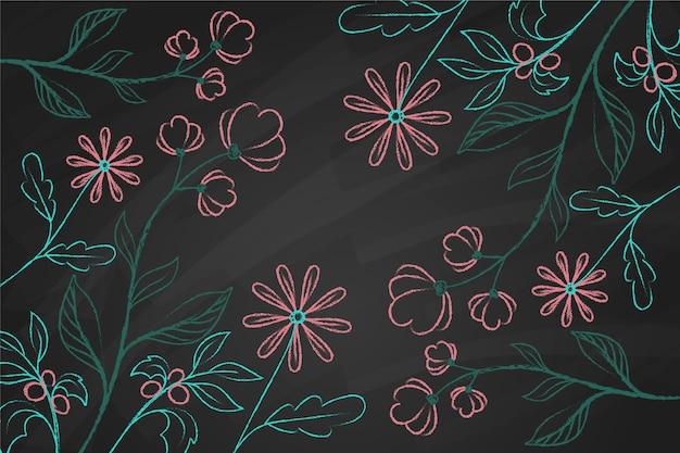 Fiori disegnati a mano di scarabocchio sul fondo della lavagna