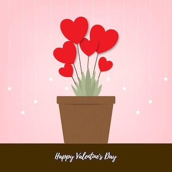 Fiori rossi del cuore in vaso marrone