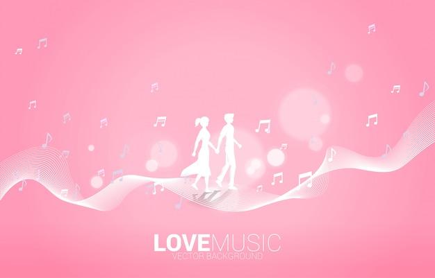 Flusso di dancing della nota di melodia di musica di camminata della mano della tenuta delle coppie dell'amante. sfondo di concetto per la canzone d'amore e il tema del concerto.