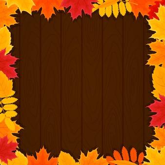 Fogli di autunno intorno ad una priorità bassa di legno. illustrazione vettoriale con tema autunnale.
