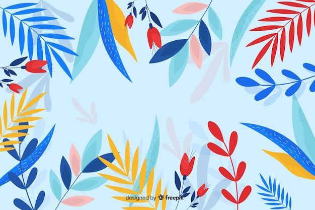 Fogliame di primavera con sfondo blu