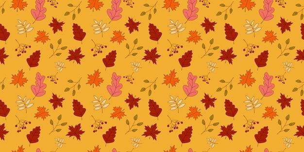 Foglie di autunno senza cuciture in arancio, beige, marrone e giallo.