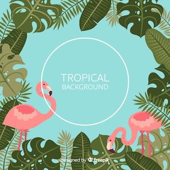 Foglie tropicali e sfondo di fenicotteri