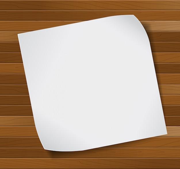 Foglio di carta su sfondo in legno.