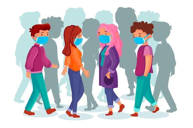 Folla di persone che indossano maschere per il viso all'aperto