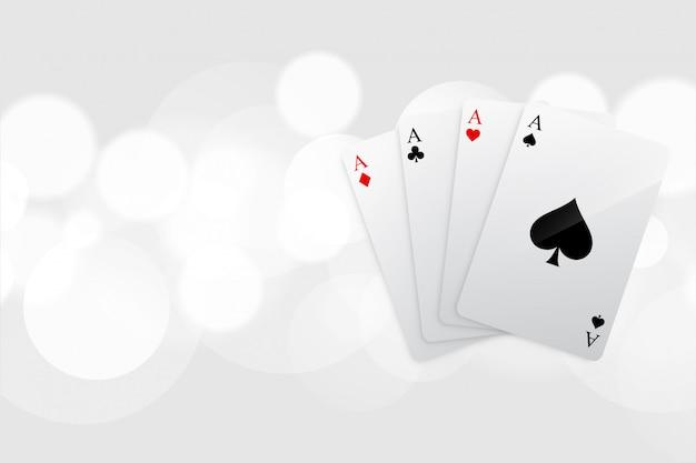 Fondo bianco del bokeh dell'asso delle carte da gioco