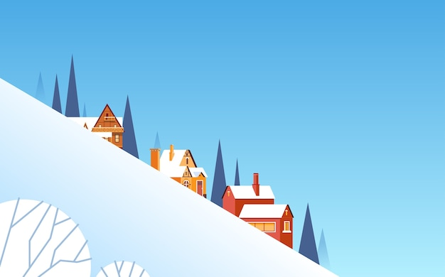 Fondo del paesaggio del villaggio del pendio di montagna di inverno