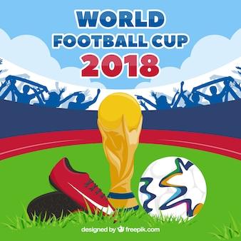 Fondo della tazza di calcio del mondo con il trofeo e la palla