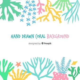 Fondo di corallo di colore pastello disegnato a mano