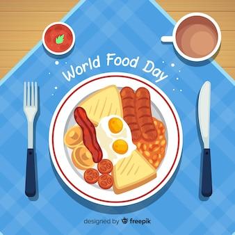 Fondo di giorno dell'alimento del mondo con alimento sul piatto