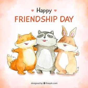 Fondo di giorno di amicizia con animali felici
