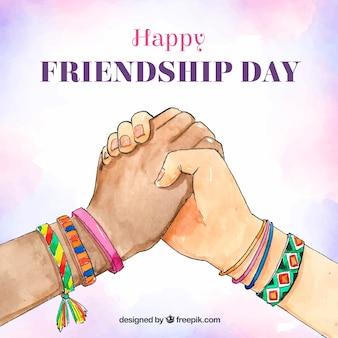 Fondo di giorno di amicizia con le mani