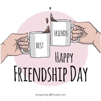 Fondo di giorno di amicizia con tazze di caffè